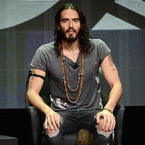 Russell Brand tried to hit on Mila Kunis