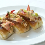 Posh lobster in not-so-posh hot dog buns