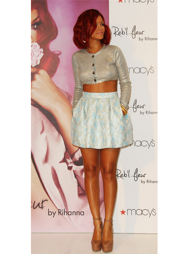 Rihanna wears silver crop top and mini skirt