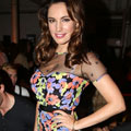YAY OR NAY: Kelly Brook's bright florals at LFW Moschino show