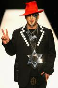 Boy George charged with false imprisonment