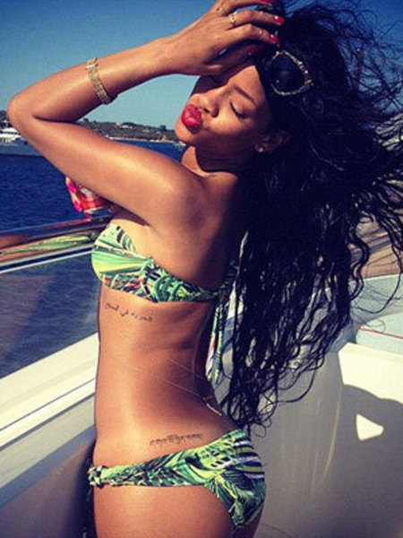 STYLE STALKER: Rihanna's giving us holiday envy on Twitter with bikinis, big hair and bold prints