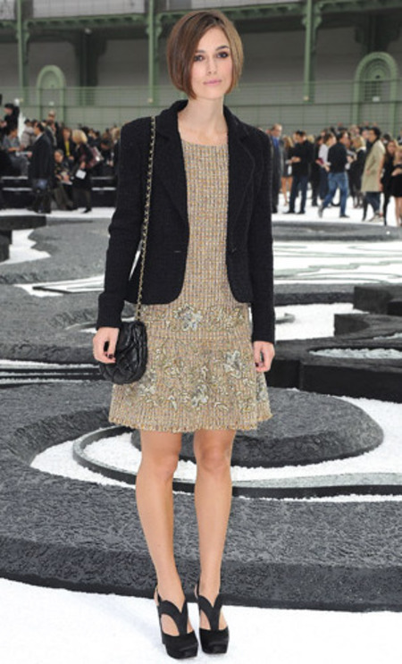 Keira Knightley wears gold and black