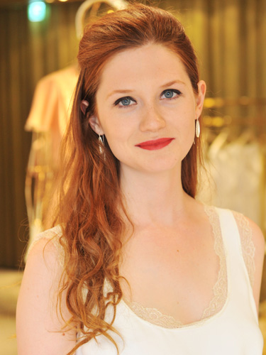 Bonnie Wright with half-up red hair