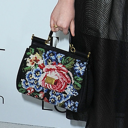 Elle Fanning with Dolce & Gabbana needlepoint bag and shoes at Elle Women In Hollywood Celebration