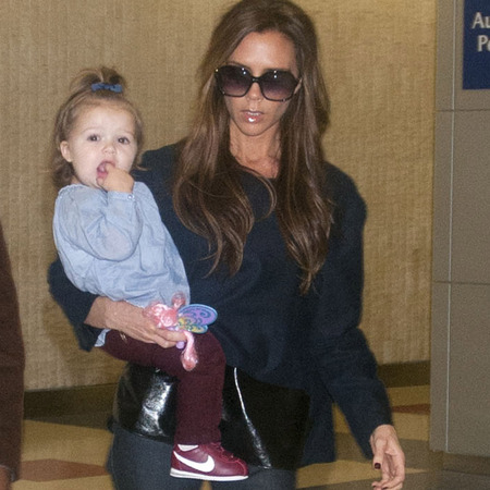 Victoria Beckham and Harper at airport