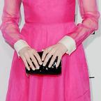 SPOTTED! Emma Stone's shiny Valentino clutch