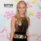AnnaSophia Robb glams up in gold peplum dress