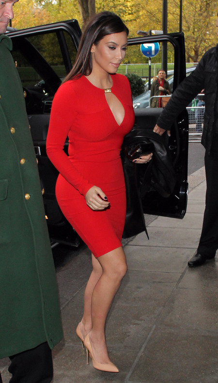 Kim Kardashian does plunging red in London