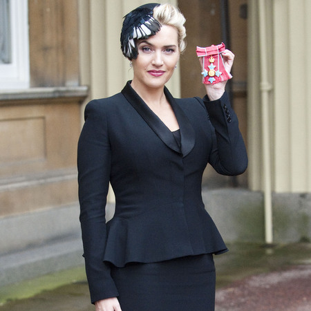 Kate Winslet in Alexander McQueen collecting CBE for services to theatre and drama