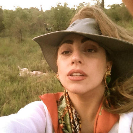 Lady Gaga turns bling-up Safari Barbie with customised bush hat