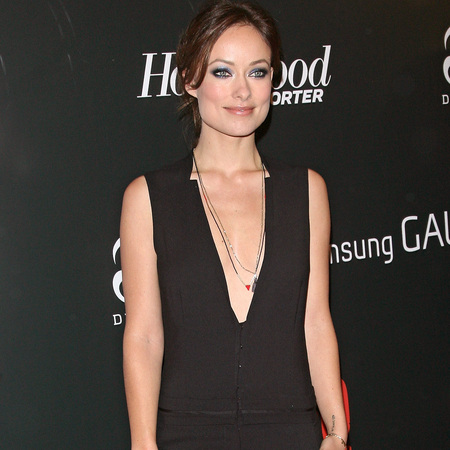 Olivia Wilde suits up in plunging jumpsuit at Django Unchained premiere