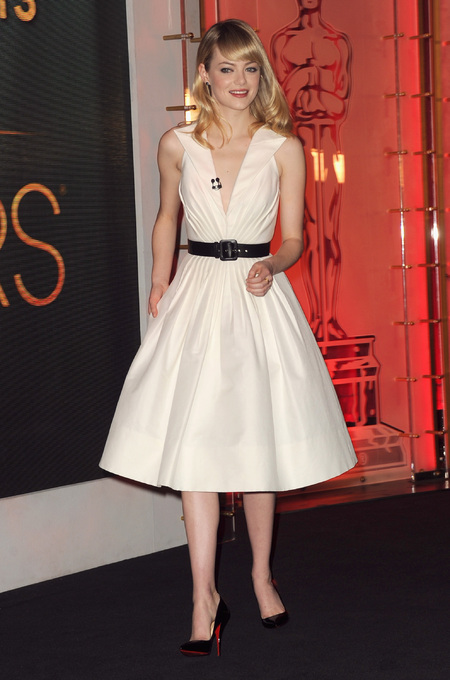 Emma Stone in off-white dress