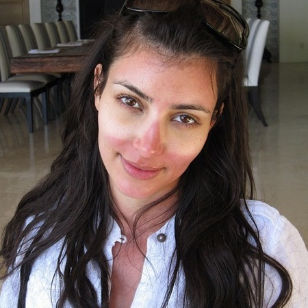 Kim Kardashian shows off sunglasses tan lines