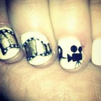 NAIL ART: Zooey Deschanel shows off Golden Globe film reels