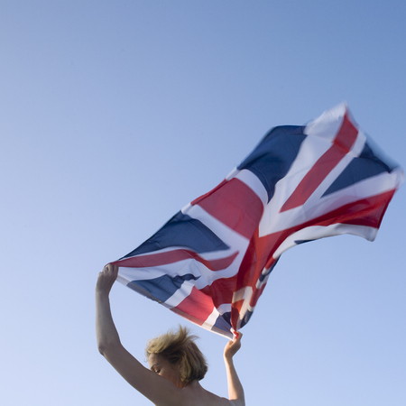 Woman waving union jack