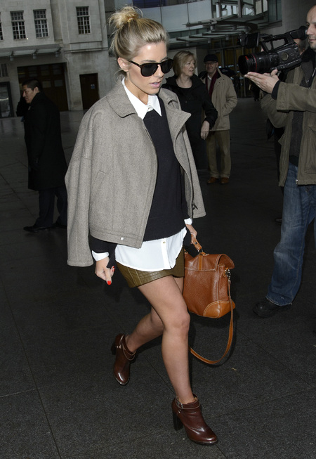 Mollie King in London with Aspinal Mollie satchel