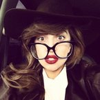 Lady Gaga teams geek chic with statement lips
