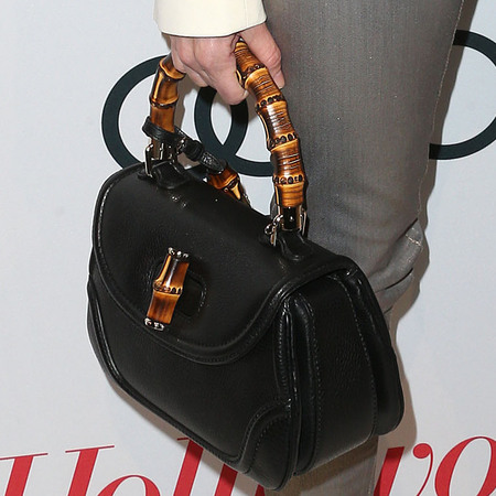 Naomi Watts with Gucci Bamboo handbag at Oscars nominations party 2013