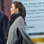 Kate Middleton hides baby bump under Zara cape