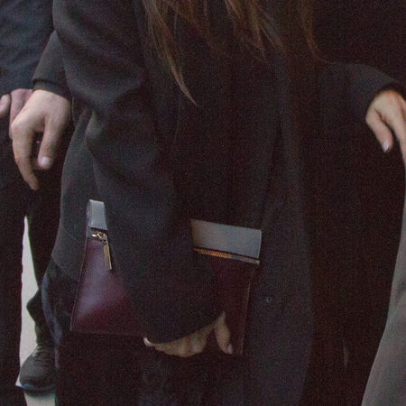 Victoria Beckham's burgundy clutch bag