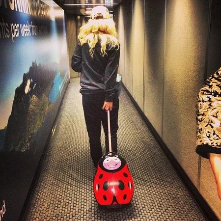 Rita Ora with ladybug suitcase