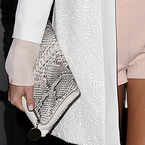 MILLIE MACKINTOSH CARRIES ASPINAL'S MILLIE CLUTCH