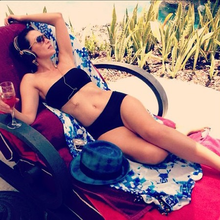Dannii Minogue relaxing in a bikini in Barbados