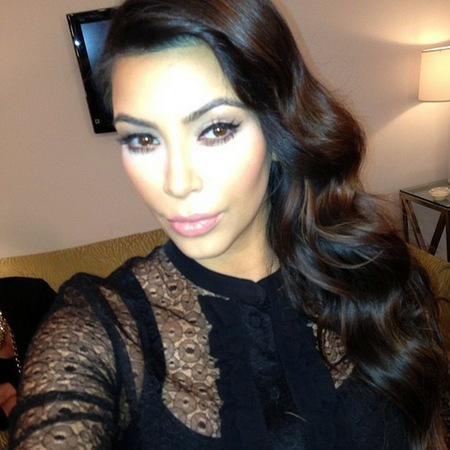 Kim Kardashian hiding fringe with waves