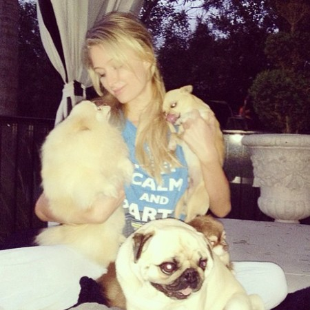 Paris Hilton is thrilled to be home with her pet dogs