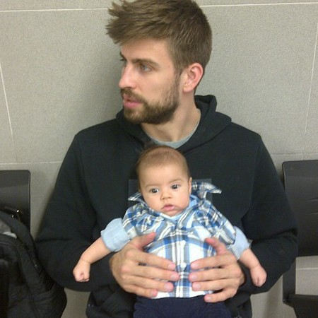Shakira's fiance Gerard Pique with Baby Milan in the passport office