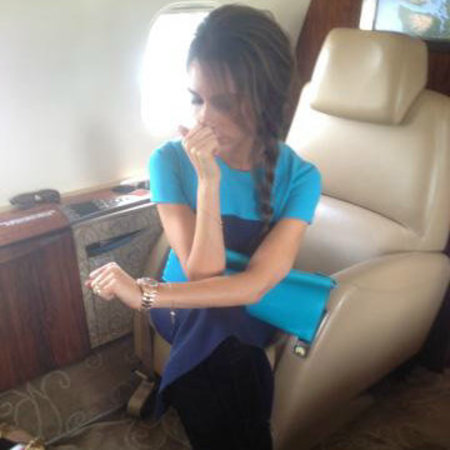 Victoria Beckham's bright blue clutch bag