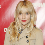 Sienna Miller rocks new fringe with red lips