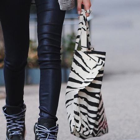 Cara Delevingne with zebra print canvas tote bag