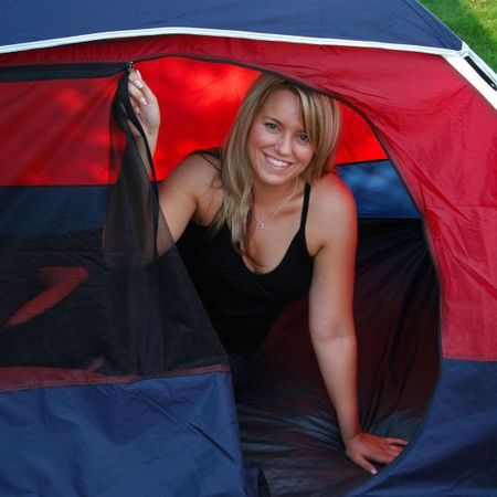 Girl smiling in a tent