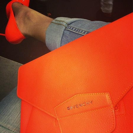 Khloe Kardashian with orange Givenchy clutch bag