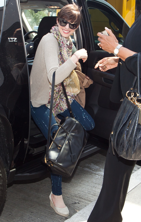 Anne Hathaway with Saint Laurent Duffle bag