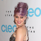 Kelly Osbourne works wispy purple beehive for CLEO bash