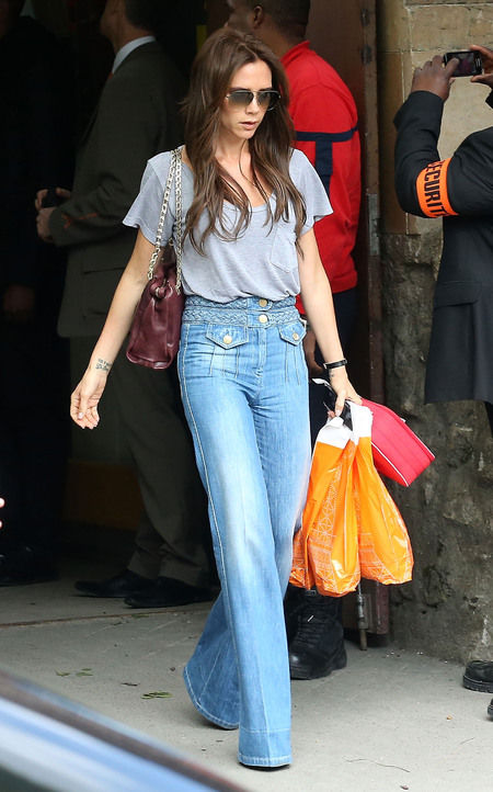 Victoria Beckham wears flared jeans in Paris