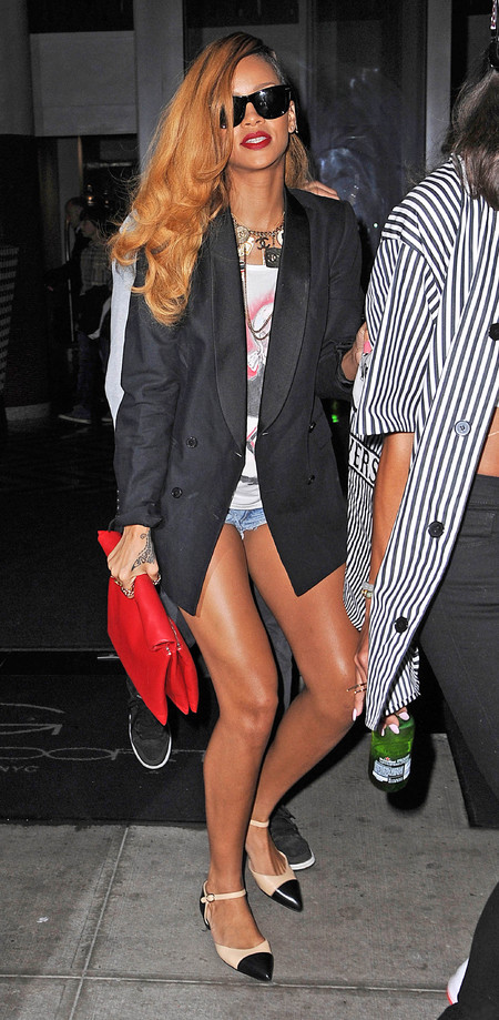 Rihanna with Céline paper bag clutch