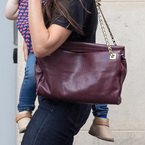 CELEB BAGS: Victoria Beckham's aubergine bag