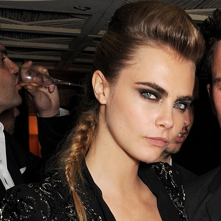 Cara Delevingne shows off her tattoo in Cannes with Jeremy Irvine