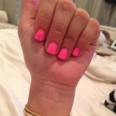 Kim Kardashian's short neon nails