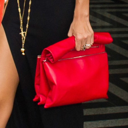 Rihanna with red Celine handbag and River Island maxi dress