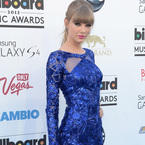 Taylor Swift sexes up blue mini at Billboard Awards