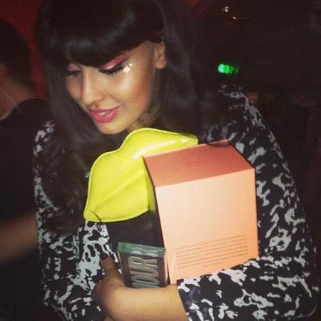 Jameela Jamil with yellow Lulu Guinness clutch bag
