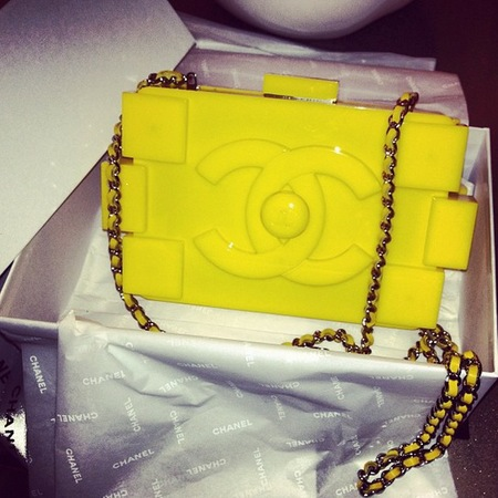 Rihanna yellow Chanel Lego Clutch bag