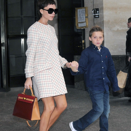 Victoria Beckham's red and tan bag
