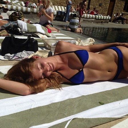 Millie Mackintosh sunbathes in blue bikini on holiday with Professor Green