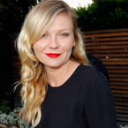 RED LIPS: Kirsten Dunst perfects the party pout